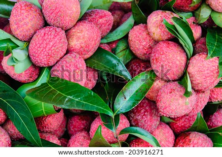 Close-up of red fresh Lychee fruits in Thailand market - stock photo