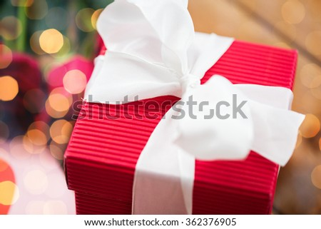 close up of red gift box with white bow