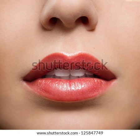 Close up of red glossy female lips - stock photo