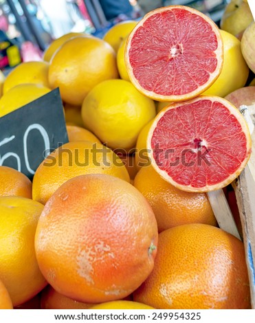 Close up of red grapefruit on market stand - stock photo
