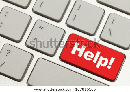 Close Up of Red Help Key Button on Keyboard. - stock photo