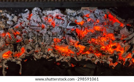Close Up of Red Hot Coals in Pit of Barbecue Grill Reading for Outdoor Cooking - stock photo