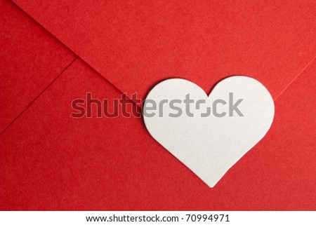 close-up of red paper envelope with white heart - stock photo