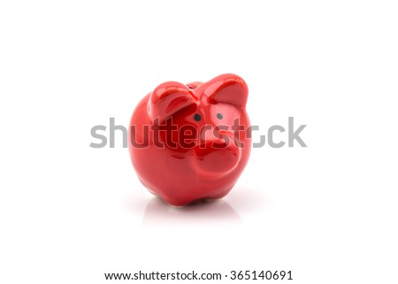 Close up of red piggy bank isolated on white background - stock photo