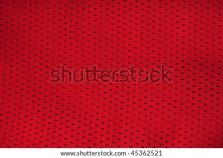 Close up of red polyester nylon red basketball sportswear shorts to created a textured background. - stock photo