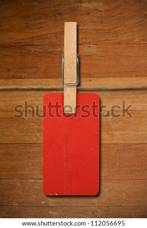 close up of red post it reminders and clothespins on wood - stock photo