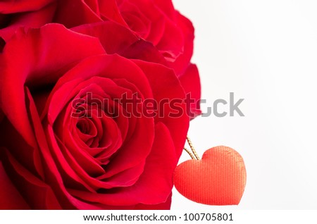 Close up of red rose and heart on white background - stock photo