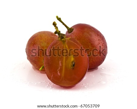 Close up of red sliced grapes with on white background.