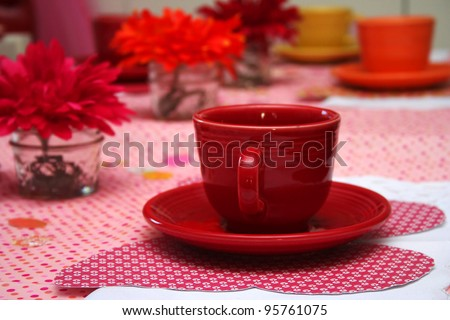Close up of Red Tea Cup at a Little Girl's Tea Party - stock photo