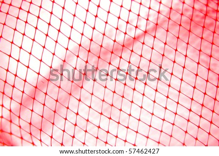 Close-up of red tone fishing netting - stock photo
