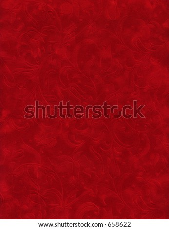 Close up of red velvet paper with embossed flowers. - stock photo