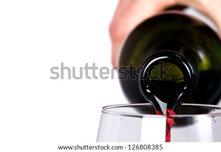 close up of red wine pouring in the glass - stock photo