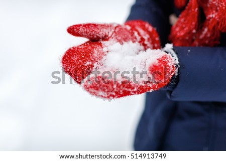 Close up of red wool gloves