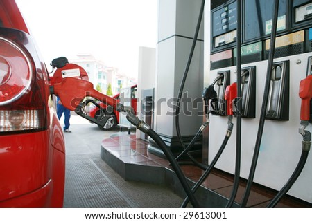 close-up of  refilling the car with a gas pump - stock photo