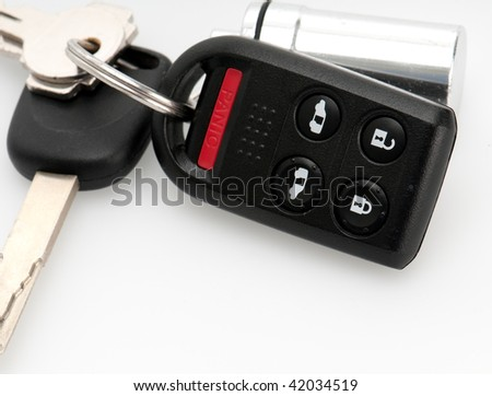 Close up of remote keyless and car keys. - stock photo