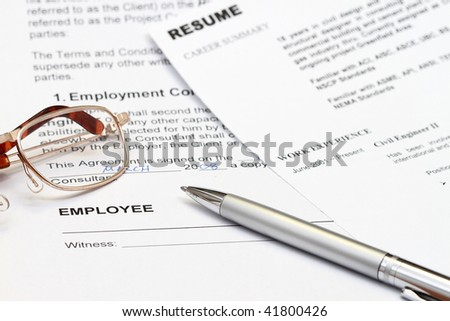 close up of resume form with employment contract ready to sign. - stock photo