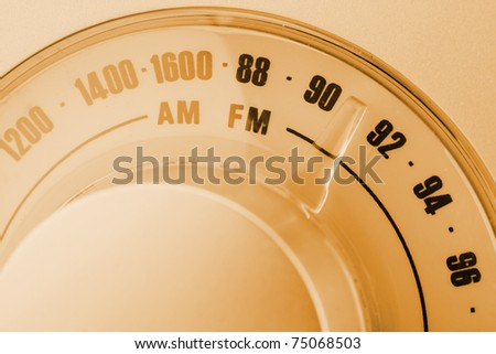 Close-up of retro-styled radio tuner dial. Sepia toned - stock photo