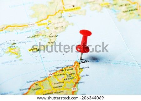 Close up of  Rhodes  island Greece  map with red pin  - Travel concept - stock photo