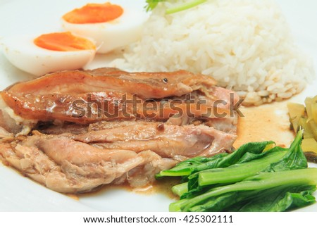 Close up of rice with stewed pork leg and vegetable and duck egg (selective focus)