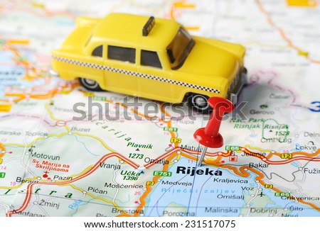 Close up of  Rijeka ,Croatia   map with red pin and a taxi toy   - Travel concept - stock photo