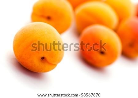 Close-up of  ripe apricots isolated on white background.