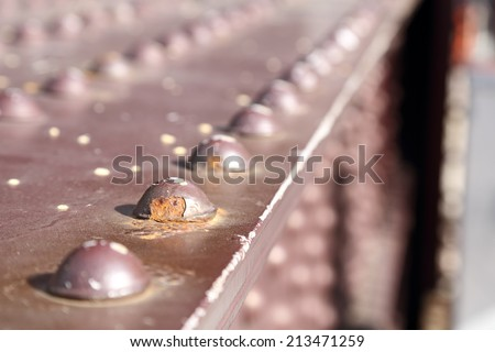 Close up of rivets on an old bridge. - stock photo