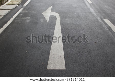 Close up of road lane with left arrow - stock photo