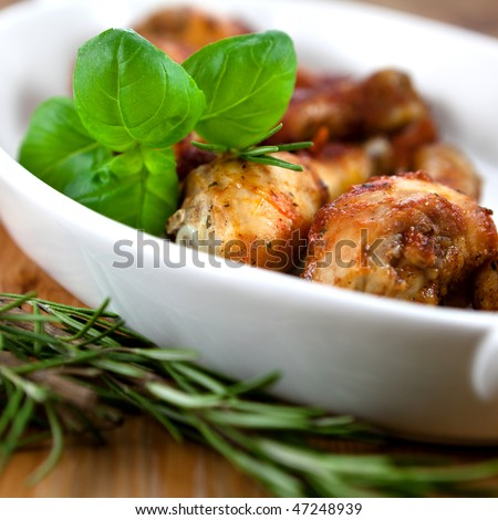 Close up of roast chicken and fresh herbs - stock photo