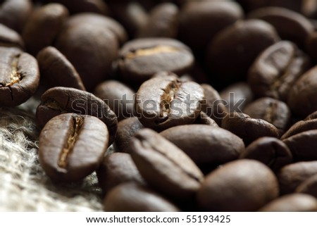 Close up of roasted coffee beans on a burlap sack