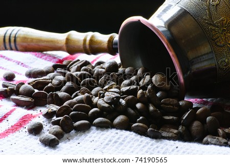 Close-up of roasted coffee beans poured from the turk. - stock photo