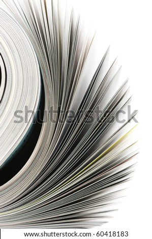 Close-up of rolled magazine isolated on white background. - stock photo