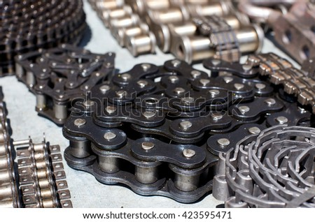 Close up of rolled new motor chains - stock photo