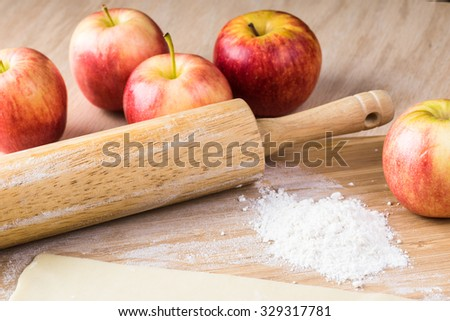Close up of roller and crust for apple roses pie. - stock photo