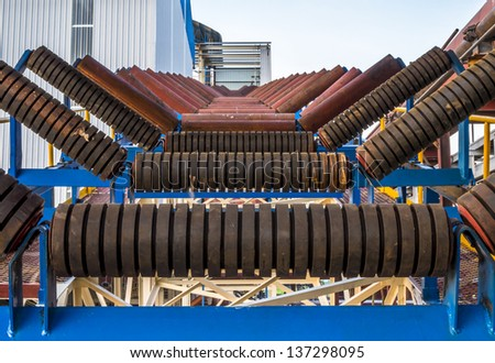 Close up of roller conveyor in factory - stock photo