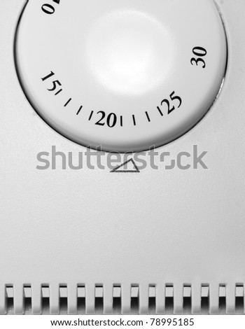 Close-up of room thermostat dial. In B/W - stock photo