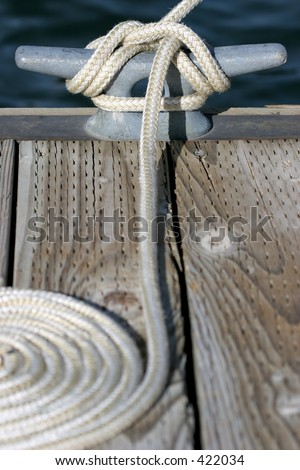 close up of rope and cleat, a sailboat docked at the marina in yellowstone national park, wyoming