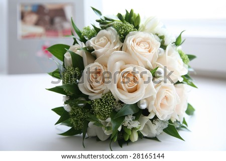 Close-up of rose bouquet decorated with pearls and other decorative flowers and plants - stock photo