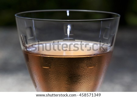 Close up of rose wine in a crystal glass - stock photo