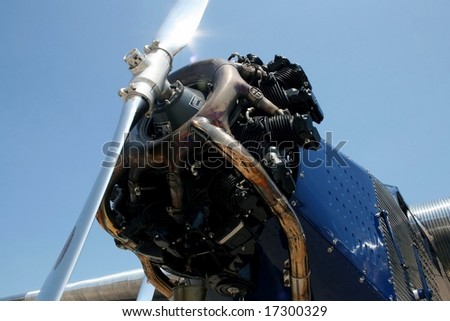 close up of rotary engine on vintage airplane - stock photo