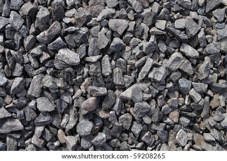 Close up of rough gray gravel background - stock photo