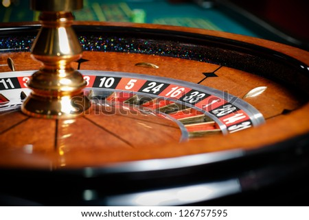 Close up of roulette at the casino. Symbol of addiction to the gambling - stock photo