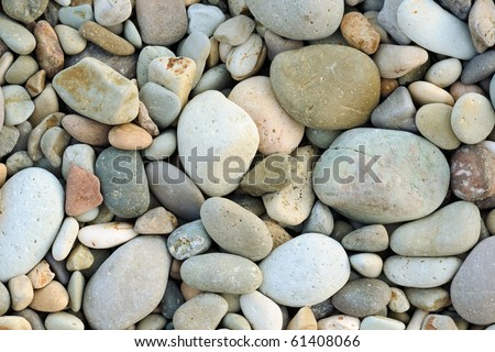 Close up of rounded and polished beach rocks - stock photo