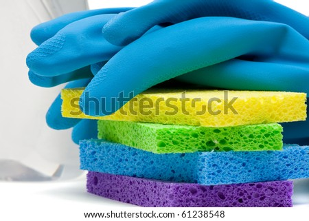 Close up of rubber gloves and sponges over white background - stock photo
