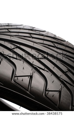 Close-up of rubber tyre tread. White background - stock photo