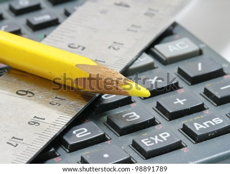 close-up of ruler,calculator and pencil - stock photo
