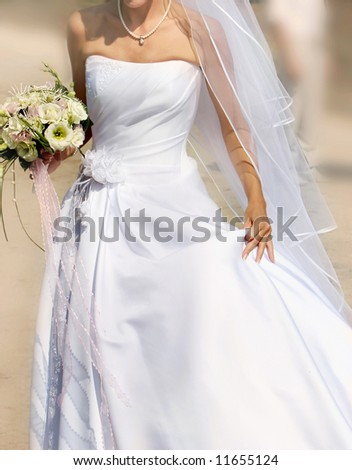close up of running bride - stock photo