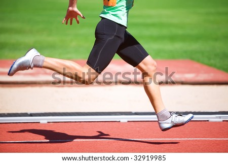 Close- up of running legs of the sportsman on ar path in movement - stock photo