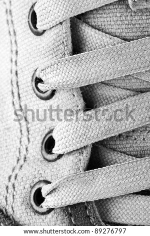Close-up of running shoe laces. In B/W - stock photo