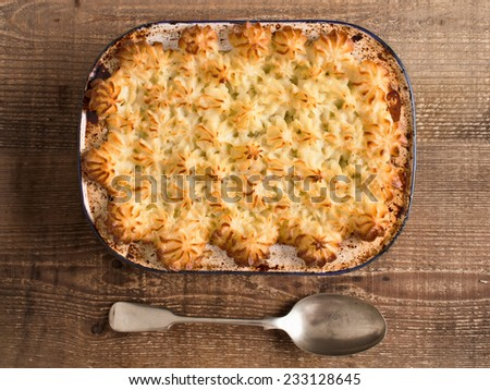 close up of rustic traditional british shepard pie - stock photo