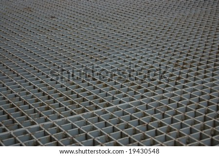 Close up of rusty grate on inner-city streets - stock photo